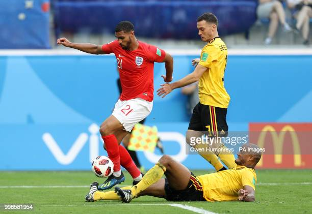 England's Ruben LoftusCheek battles with Belgium's Vincent Kompany and Thomas Vermaelen during the FIFA World Cup third place playoff match at Saint...