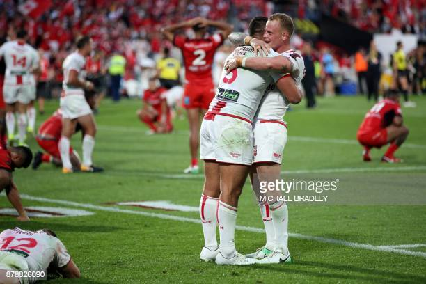 England's Ryan Hall and Kevin Brown celebrate after the Rugby League World Cup men's semifinal match between Tonga and England at Mt Smart Stadium in...