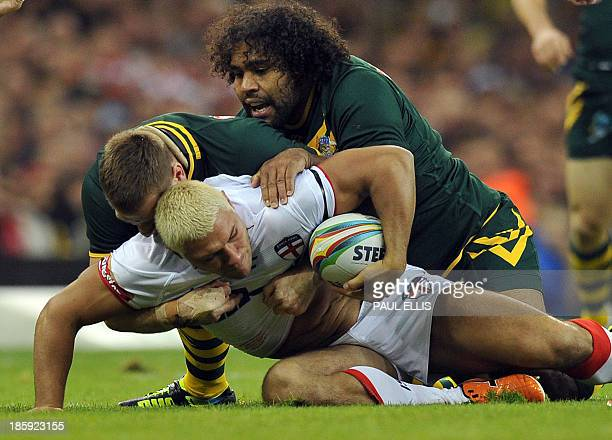 England's Ryan Hall is tackled by Australia's Sam Thaiday during the 2013 Rugby League World Cup group A match between Australia and England at the...