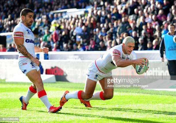 England's Ryan Hall scores the opening try watched by Rangi Chase during the 2013 World Cup match at the John Smith's Stadium Huddersfield