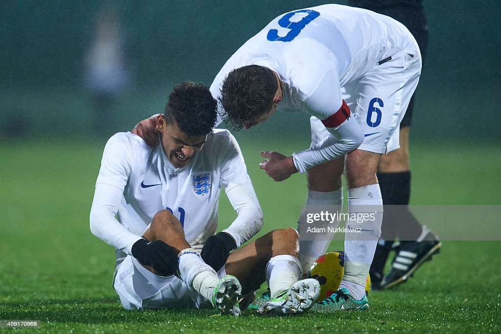 England's Ryan Ledson (R) helps to England's Dominic Solanke (L) during the international friendly match Under-18 between Poland and England on November 17, 2014 on the MOSiR Stadium in Gdansk, Poland.