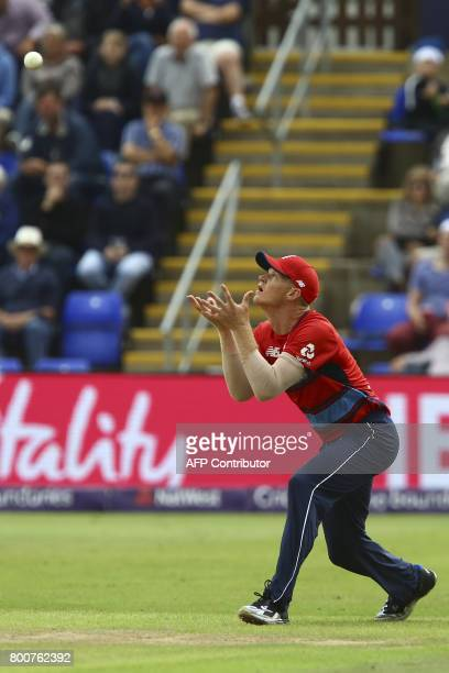 England's Sam Billings catches the ball to take the wicket of South Africa's Farhaan Behardien during the third Twenty20 international cricket match...