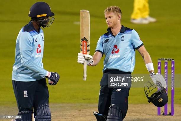 England's Sam Billings reacts after reaching his century during the oneday international cricket match between England and Australia at Old Trafford...