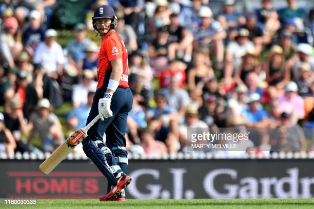 England's Sam Billings walks from the field after being run out during the Twenty20 cricket match between New Zealand and England at Saxton Oval in...