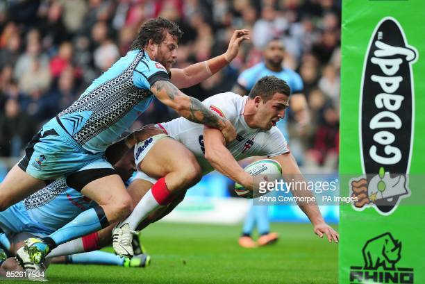 England's Sam Burgess is prevented from scoring a try by Fiji's Ashton Sims during the 2013 World Cup match at the KC Stadium Hull
