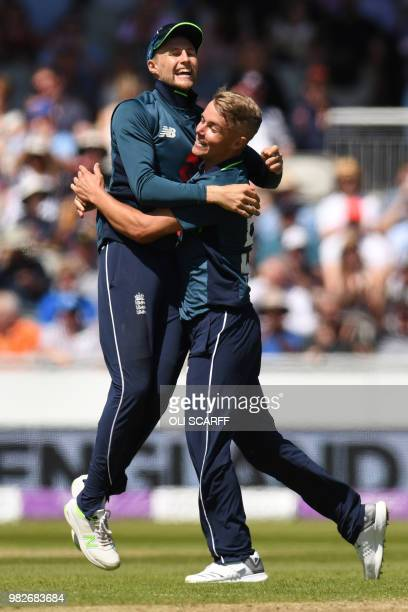 England's Sam Curran celebrates with England's Joe Root after taking the wicket of Australia's Alex Carey during the fifth One Day International...