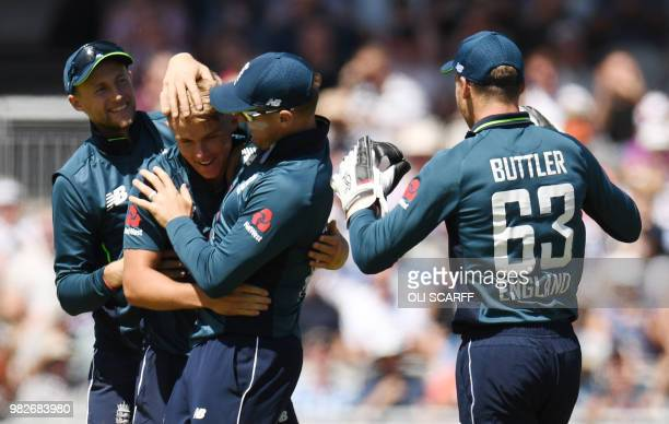 England's Sam Curran celebrates with teammates after taking the wicket of Australia's Alex Carey during the fifth One Day International cricket match...