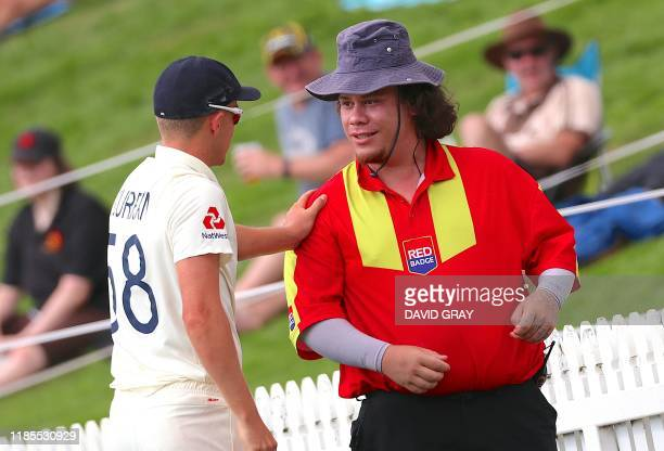 England's Sam Curran checks on a security guard who was hit by the ball during the day two of the second cricket Test match between England and New...
