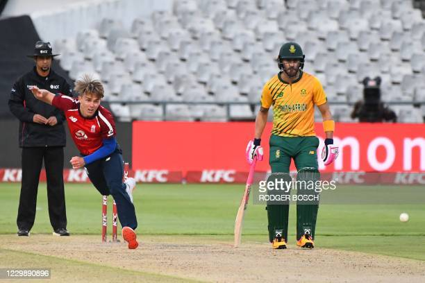 England's Sam Curran delivers a ball as South Africa's Faf du Plessis looks on during the third T20 international cricket match between South Africa...