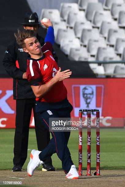 England's Sam Curran delivers a ball during the first T20 international cricket match between South Africa and England at Newlands stadium in Cape...