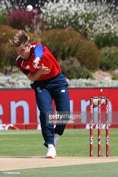 England's Sam Curran delivers a ball during the second T20 international cricket match between South Africa and England at Boland Park stadium in...