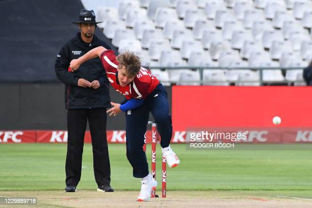 England's Sam Curran delivers a ball during the third T20 international cricket match between South Africa and England at Newlands stadium in Cape...