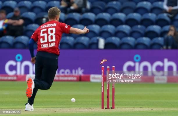 England's Sam Curran kicks to ball into the stumps to take the wicket of Sri Lanka's Danushka Gunathilaka for three runs during the second T20i...
