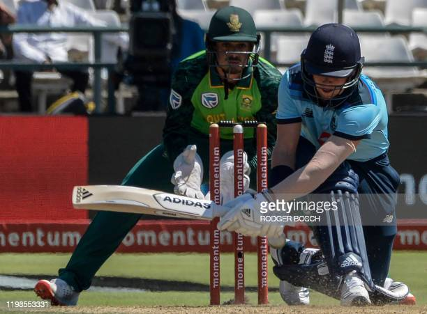 England's Sam Curran looks towards the ball breaching his defence as he is bowled while South Africa's wicketkeeper Quinton de Kock looks on during...