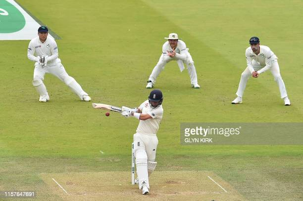 England's Sam Curran plays a shot on the second day of the first cricket Test match between England and Ireland at Lord's cricket ground in London on...