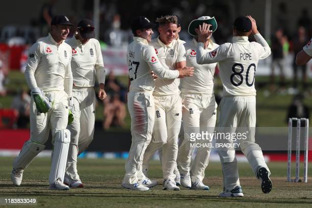 England's Sam Curran reacts after taking the wicket of New Zealand's Kane Williamson during the second day of the first cricket test between England...
