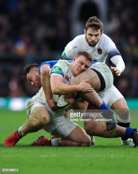 England's Sam Simmonds is tackled by Samoa's Jack Lam during the 2017 Old Mutual Wealth Series Autumn International match between England and Samoa...