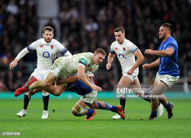 England's Sam Simmonds is tackled by Samoa's TJ Ioane during the 2017 Old Mutual Wealth Series Autumn International match between England and Samoa...