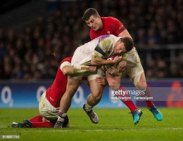 Englands' Sam Simmonds is tackled by Wales' Scott Williams during the NatWest Six Nations Championship match between England and Wales at Twickenham...