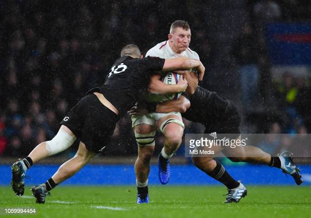 England's Sam Underhill is tackled by New Zealand's Dane Coles during the Quilter International match at Twickenham Stadium on November 10, 2018 in...