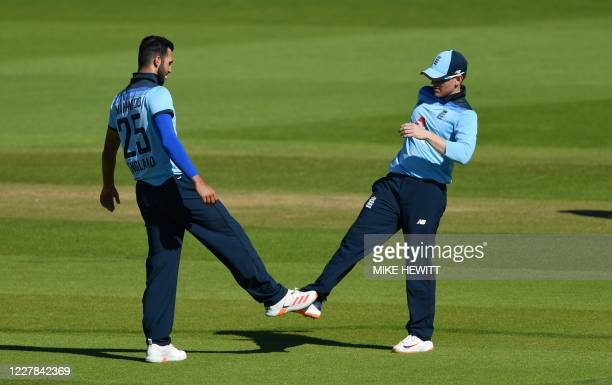 England's Saqib Mahmood touches his foot with England's Eoin Morgan after taking the wicket of Ireland's Barry McCarthy during the first One Day...