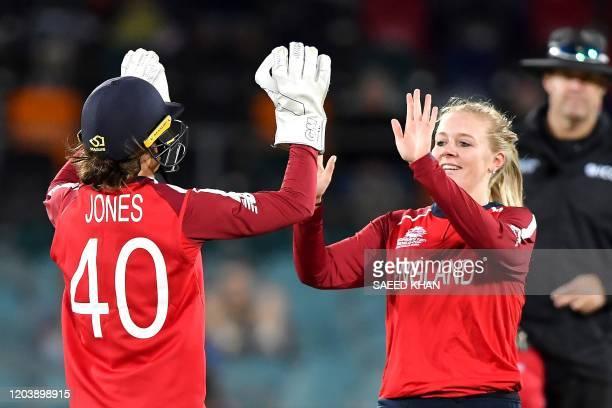 England's Sarah Glenn celebrates the dismissal of Pakistan's Javeria Khan with teammate Amy Jones during the Twenty20 women's World Cup cricket match...