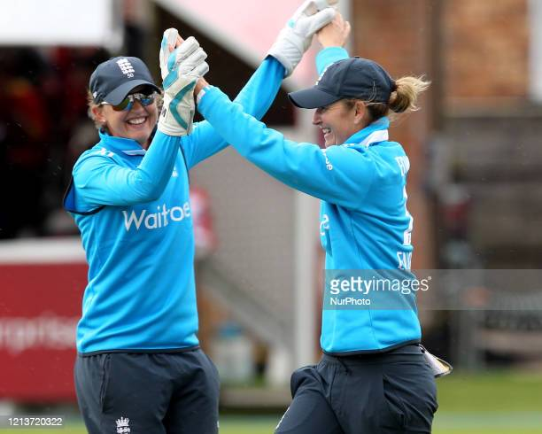 England's Sarah Taylor and Charlotte Edwards celebrate taking the wicket of India's Smriti Mandhana during the First One Day International between...