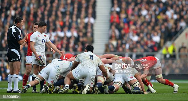 England's scrum half Ben Youngs gestures as the scrum collapses during the Six Nations international rugby union match between England and Wales at...