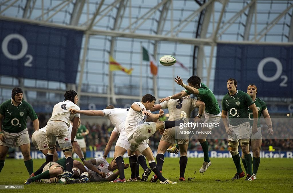 England's scrum half Ben Youngs (C) kicks the ball away to clear his line against Ireland during the Six Nations international rugby union match between Ireland and England at the Aviva Stadium in Dublin on February 10, 2013. England won the game 12-6.