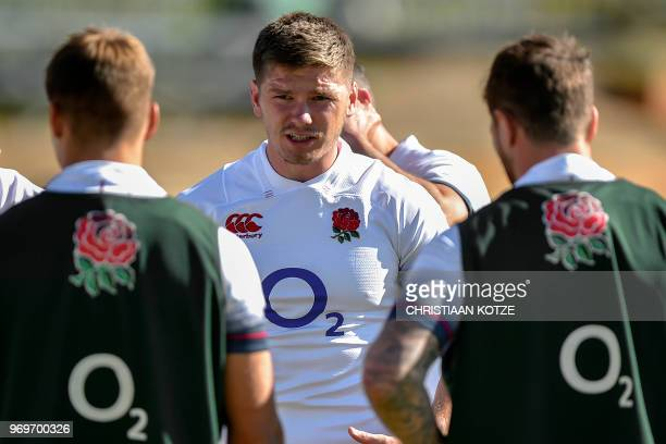 England's scrum-half and captain Owen Farrell speaks with teammates during the England's rugby team captain's run and training session June 8, 2018...