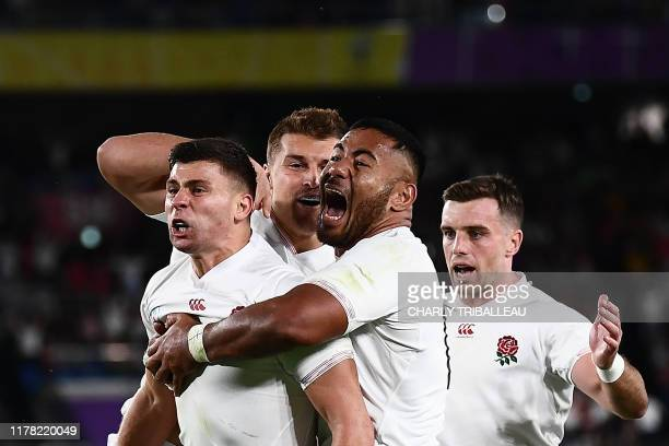 England's scrum-half Ben Youngs celebrates with England's centre Henry Slade, England's centre Manu Tuilagi and England's fly-half George Ford for a...