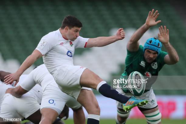 England's scrum-half Ben Youngs kicks past Ireland's lock Tadhg Beirne during the Six Nations international rugby union match between Ireland and...