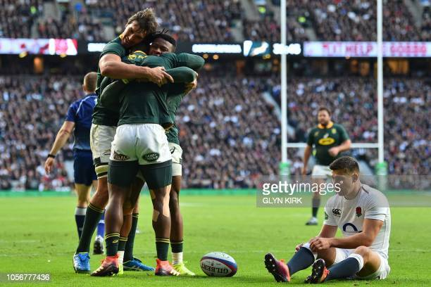 England's scrumhalf Ben Youngs reacts as South Africa's wing Sibusiso Nkosi celebrates with South Africa's lock Eben Etzebeth and South Africa's wing...