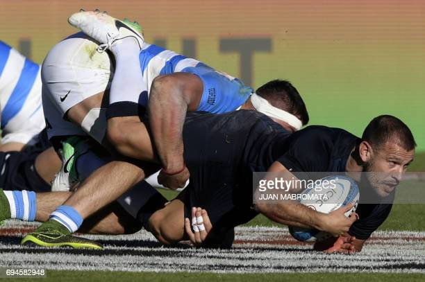 TOPSHOT England's scrumhalf Danny Care is tackled by Argentina's Los Pumas flanker Javier Ortega Desio during their Rugby Union test match at San...