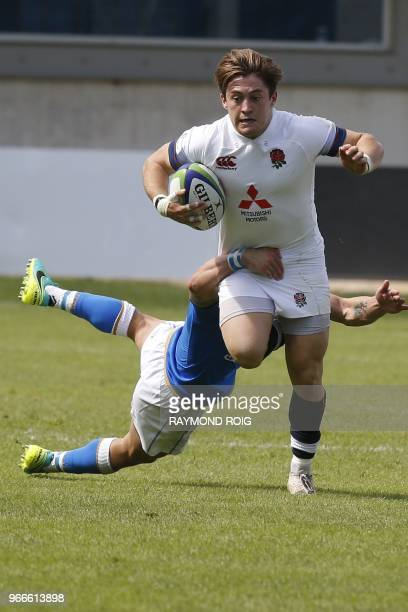 England's scrumhalf Rory Brand is tackled during the World Rugby U20 Championship 2018 Pool B match England vs Italy at the Aime Giral stadium in...