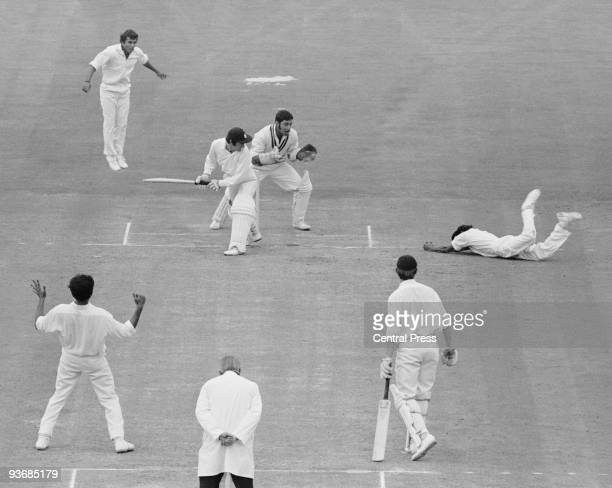 England's second innings on the fourth day's play of the Third Test at the Oval in London, 23rd August 1971. Indian fielder Eknath Solkar dives to...