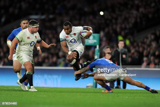 England's Semesa Rokoduguni is tackled by Samoa's Dwayne Polataivao during the 2017 Old Mutual Wealth Series Autumn International match between...