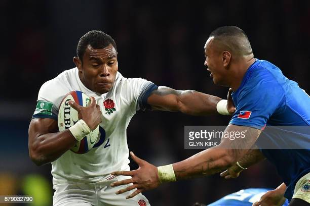 England's Semesa Rokoduguni pushes past during the autumn international rugby union test match between England and Samoa at Twickenham stadium in...