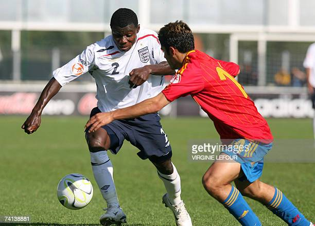 England's Seth OforiTwumasi and Spain's Lago Falque fight for the ball during final football game of the European under17 championship in Tournai...