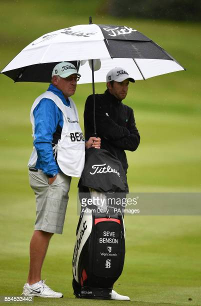 England's Seve Benson shelters under an umbrella with his caddie during day two of the BMW PGA Championship at the Wentworth Club Surrey