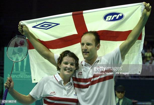 England's Simon Archer and Jo Goode celebrate winning the gold medal in badminton at the Bolton Arena during the XVII Commonwealth Games