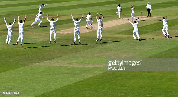England's slip fielders all go up as they appeal for lbw against Pakistan's Yasir Shah during play on the final day of the third test cricket match...