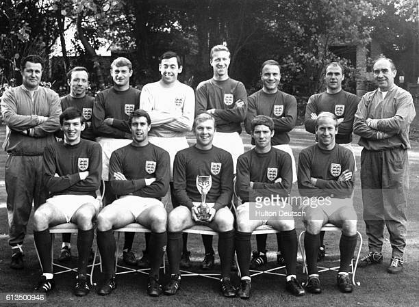 England's soccer team of 1966 the year of their victory in the World Cup Final Pictured holding the Jules Rimet trophy are players Shephardson Stiles...