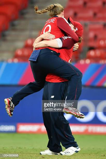 England's Sophie Ecclestone and Natalie Sciver celebrate the team's victory against West Indies during the Twenty20 women's World Cup cricket match...