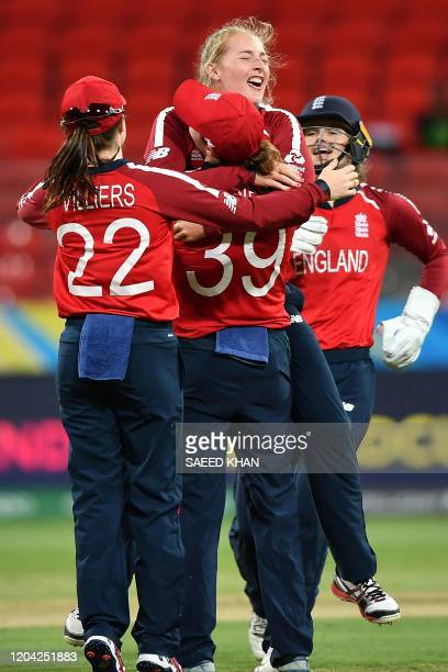 England's Sophie Ecclestone celebrates her wicket of West Indies' Deandra Dottin with a teammate Natalie Sciver during the Twenty20 women's World Cup...