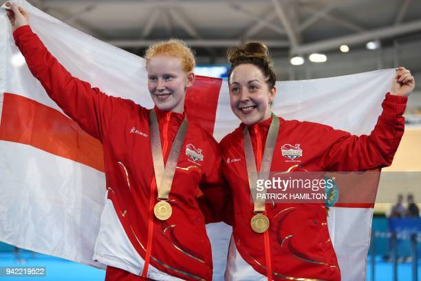 England's Sophie Thornhill and pilot Helen Scott celebrate on the podium for their gold in the women's BVI sprint finals track cycling event during...