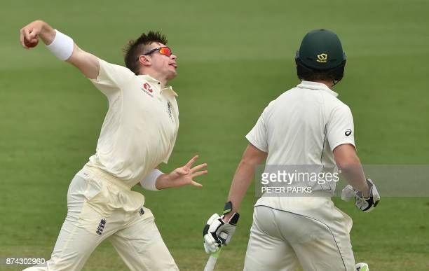 England's spinner Mason Crane bowls to Cricket Australia XI batsman Matthew Short as Will Pucovski looks on during the first day of a fourday Ashes...