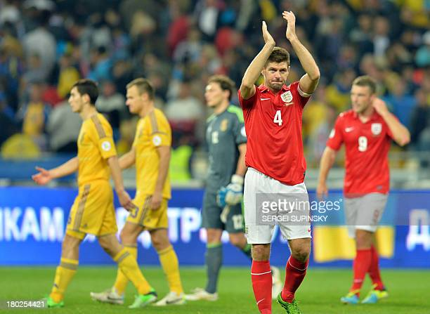 England's Sreven Gerrard greets the fans after the Brazil 2014 FIFA World Cup qualifiers Group H football match with Ukraine in Kiev on September 10...