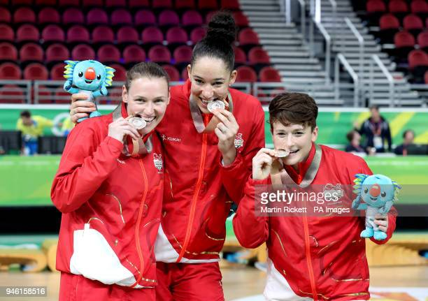 England's Stefanie Collins Azania Stewart and Rachael Vanderwal celebrate with their silver medals after the Women's Gold Medal Game at the Gold...