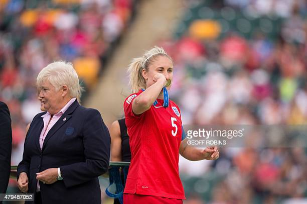 England's Steph Houghton kisses her bronze medal following England's 10 win over Germany in the bronze medal match at the FIFA Women's World Cup in...